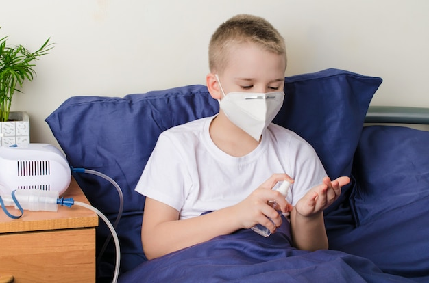 Sick boy in medical protective mask using hand sanitizer. coronavirus outbreak concept