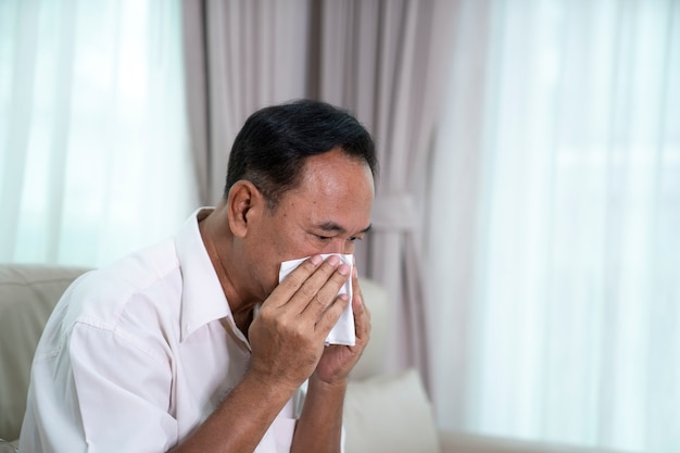 Sick elderly asian man with pills this image can use for covis19, virus and faver concept