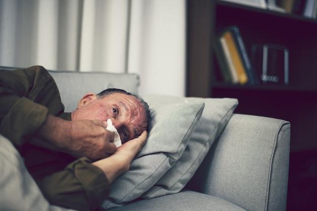 Sick elderly on a sofa