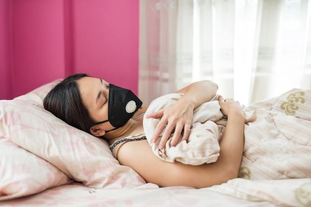 Sick girl with mask sleep on bed