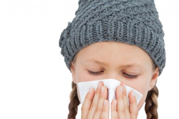 Sick little girl with an handkerchief