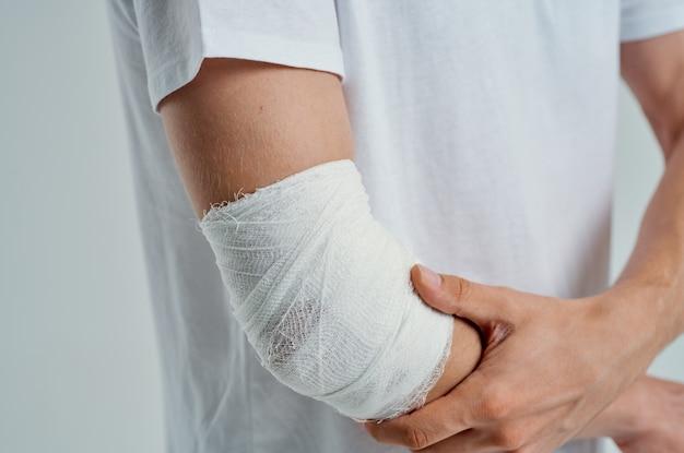 Sick man bandaged hand injury to fingers isolated background