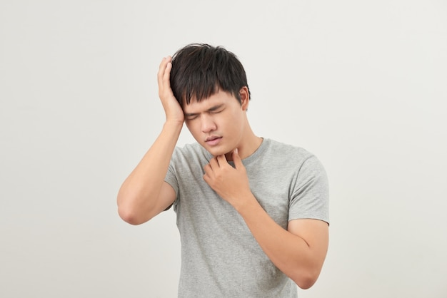 Sick man has a sore throat isolated on a white background