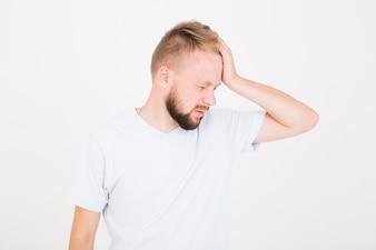 Sick man holding hand on head