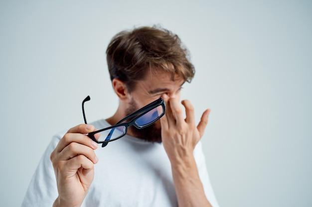 Sick man vision problems in white tshirt closeup
