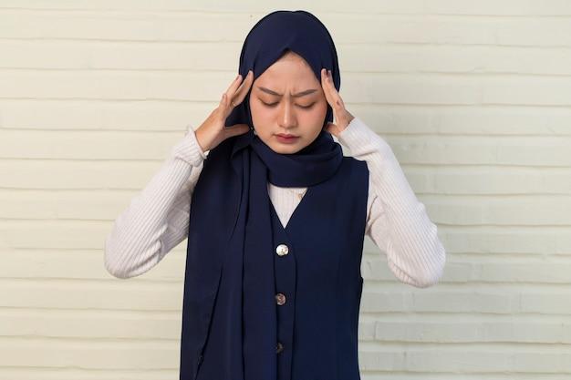 Sick muslim asian woman with headache