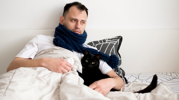 Sick person indoors with scarf
