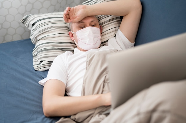 Sick person wearing a mask indoors