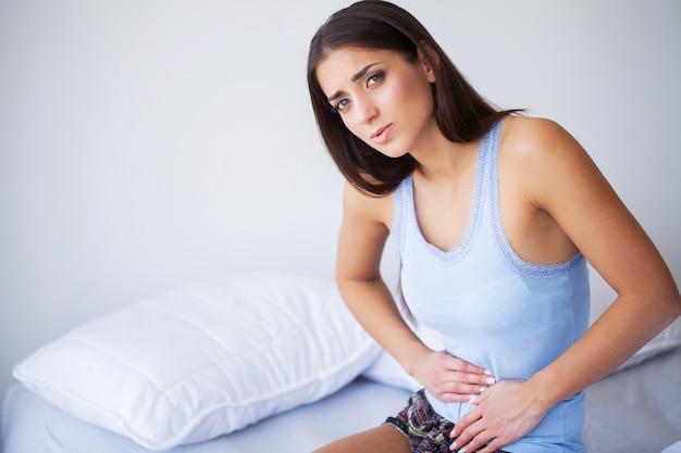 Sick woman at bed