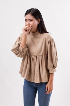 Sick woman coughing with cold or sore throat