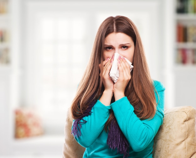 Sick woman.flu.woman caught cold. sneezing into tissue.