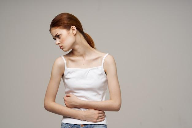 Sick woman groin pain intimate illness gynecology discomfort light background
