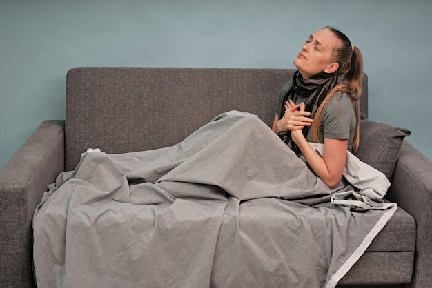 Sick woman sitting on a couch