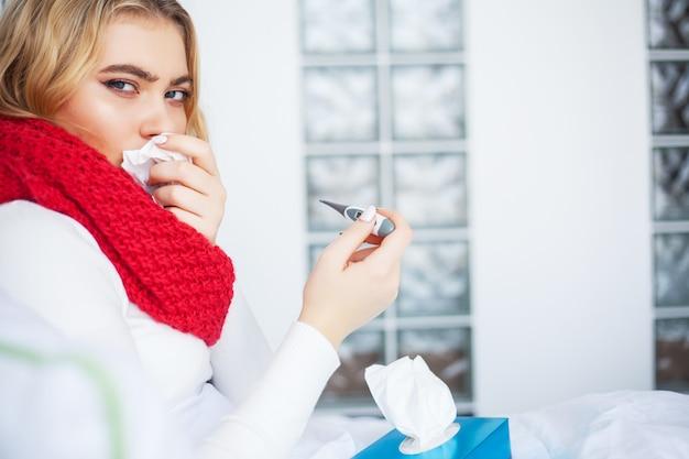 Sick woman, woman with flu virus lying in bed