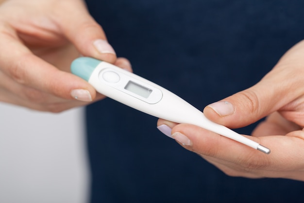 Sick women with a thermometer