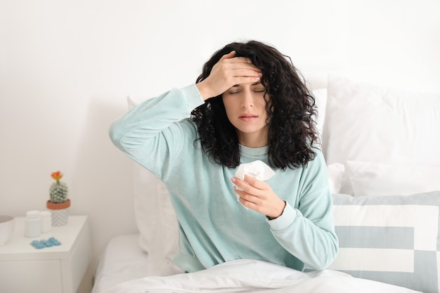Sick young woman at home