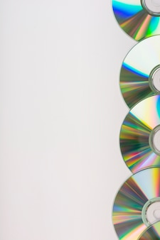 Side border made with compact discs on white background