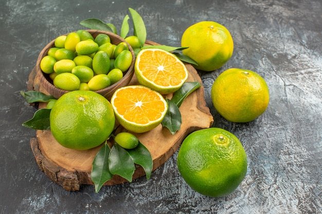 Side close-up view citrus fruits citrus fruits on the wooden cutting board