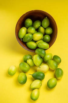 Side close-up view green fruits bowl of the appetizing green fruits on the table