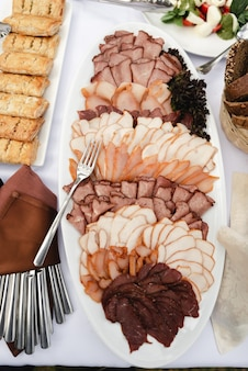 Side dish with meat,a large tray of chopped meat on the wedding table