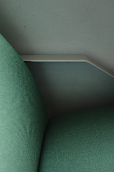 A side of a green chair