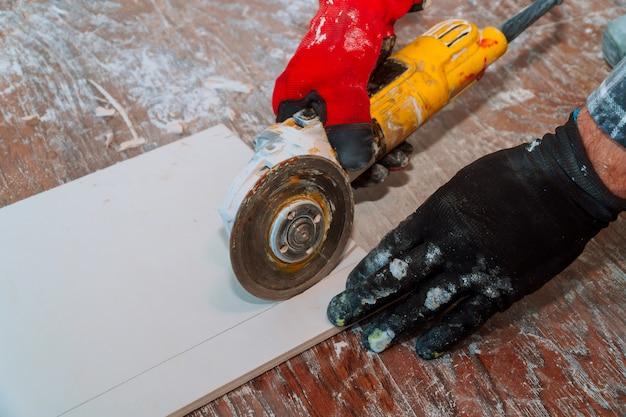 Side grinder working on paving tile on building site