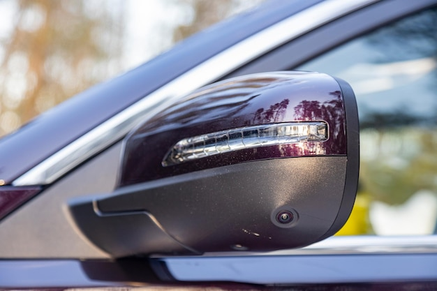 Side mirror of the rear view of a modern car with a terrain view camera parking assistant and car