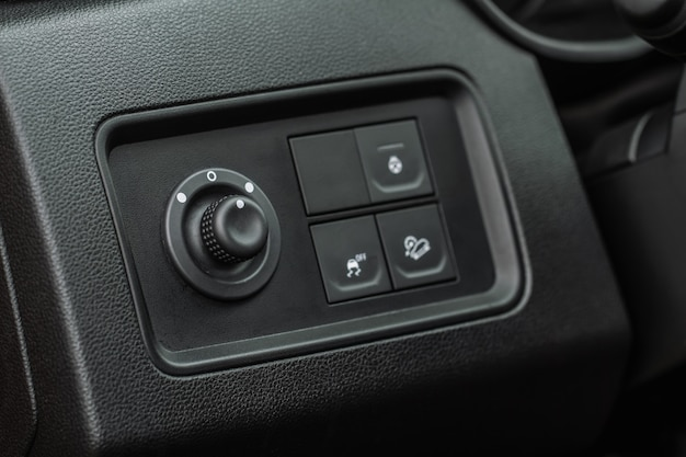Side mirrors control panel on side door. car driver adjust side mirror controller. side mirror control button for adjusting the side mirrors.