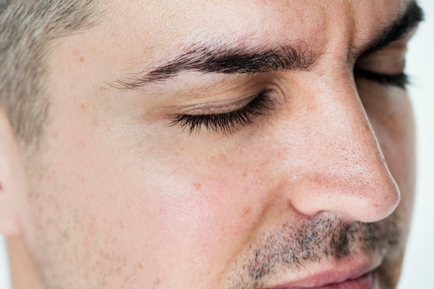 Side portrait of white man closeup on closed eyes