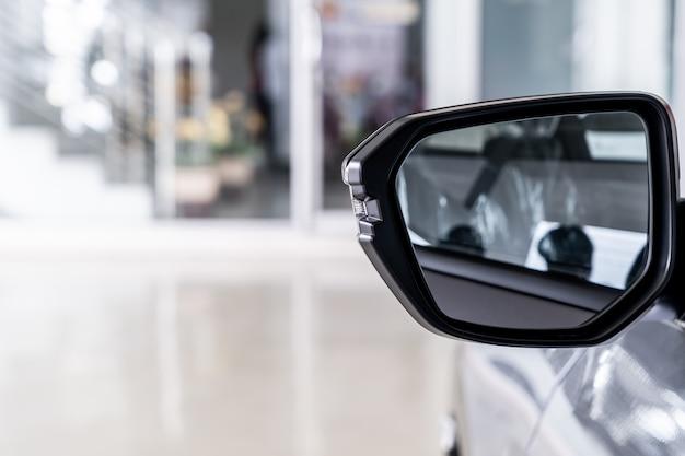 Side rear-view mirror on car