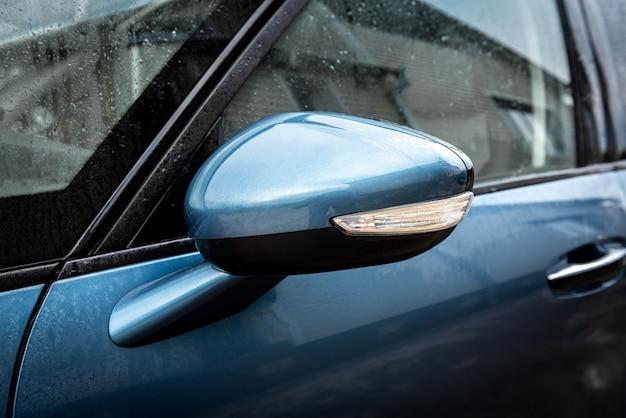 Side rear-view mirror on a modern car.
