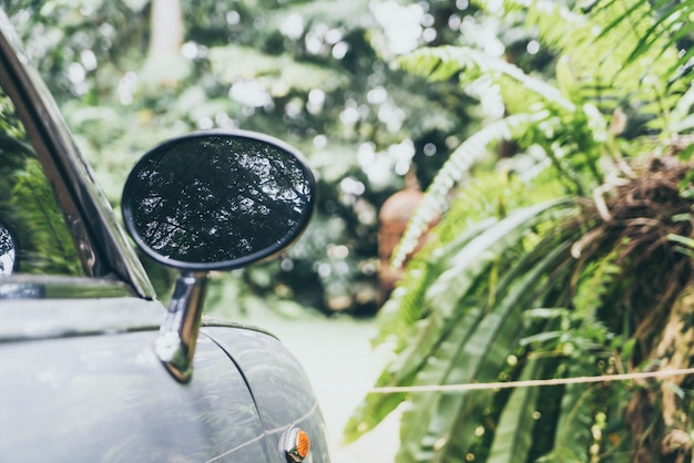 Side rear-view mirror on vintage classic car
