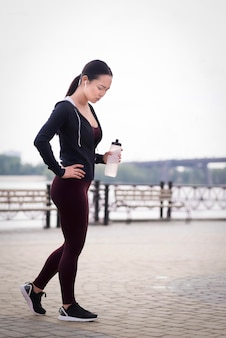 Side view active woman training outdoors