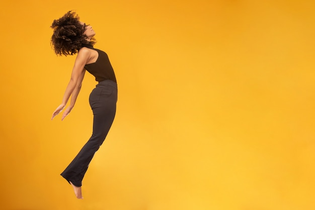 Side view of afro hair woman in zero gravity or a fall