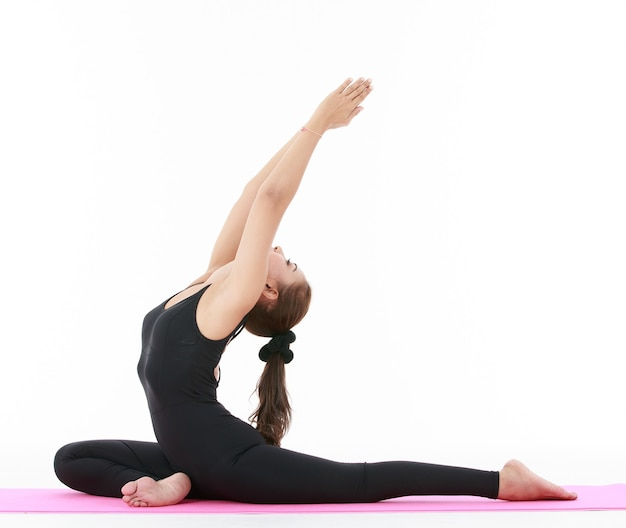 Side view of asian woman doing hanumanasana pose with raised arms while practicing yoga against white background