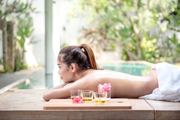 Side view of asian woman relaxing