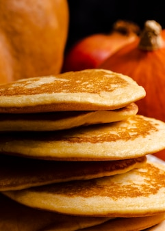 Side view assortment with pancakes in foreground