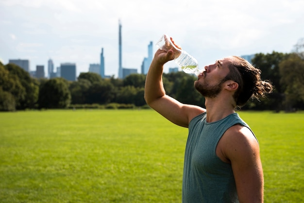 Side view of athlete drinking water