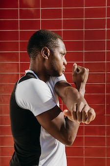 Side view athletic man stretching