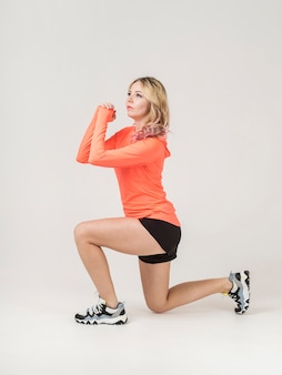 Side view of athletic woman exercising