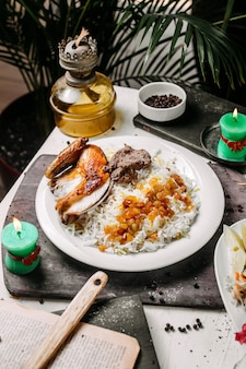 Side view of azerbaijani pilaf with roasted chicken lyavangi and roasted dried fruits