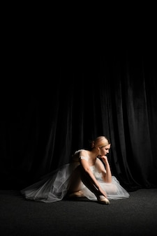 Side view of ballerina posing with copy space