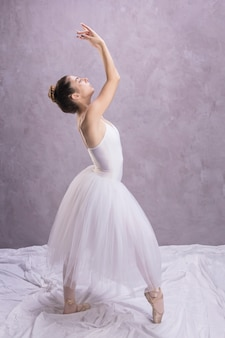 Side view ballerina standing position