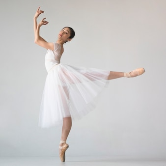 Side view of ballerina in tutu dress posing