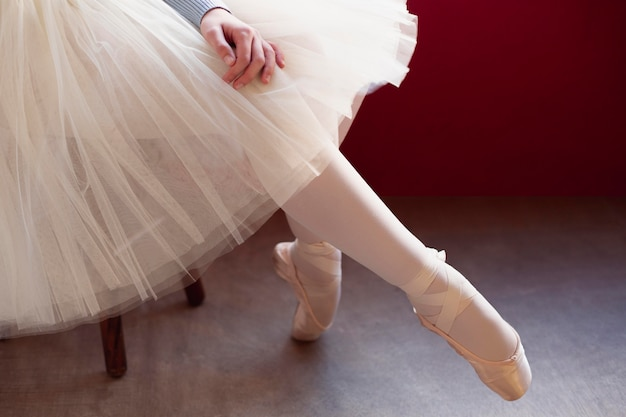 Side view of ballerina in tutu skirt and pointe shoes
