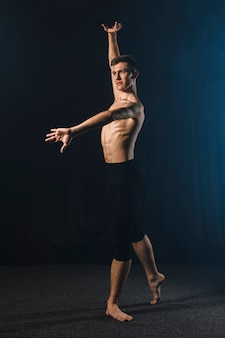 Side view of ballerino dancing in tights