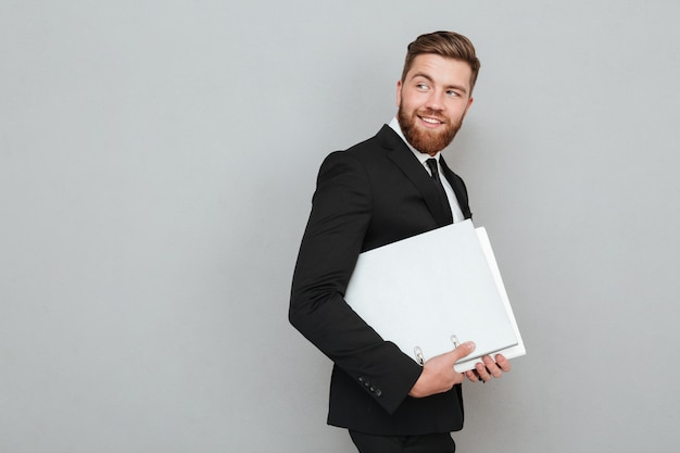 Side view of a bearded man in suit Free Photo