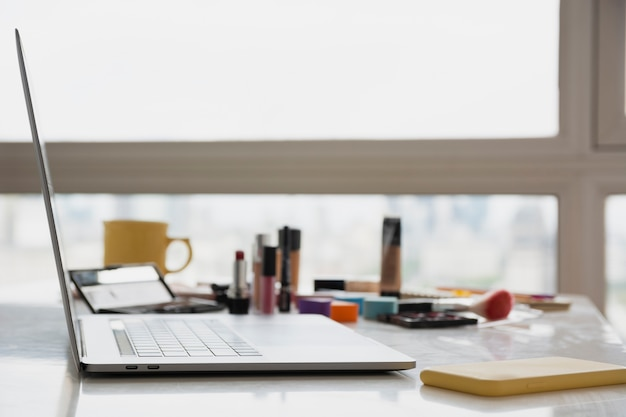 Side view beauty products on desk
