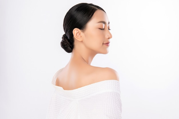 Side view of beauty woman face portrait, beautiful young asian woman with clean fresh healthy skin, facial treatment. cosmetology, beauty and spa, isolated on white wall.