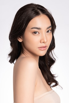 Side view of beauty woman face portrait beautiful young asian woman with clean fresh healthy skin facial treatment